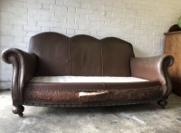 Antique French Art Deco distressed leather sofa Prop Hire from The Props List